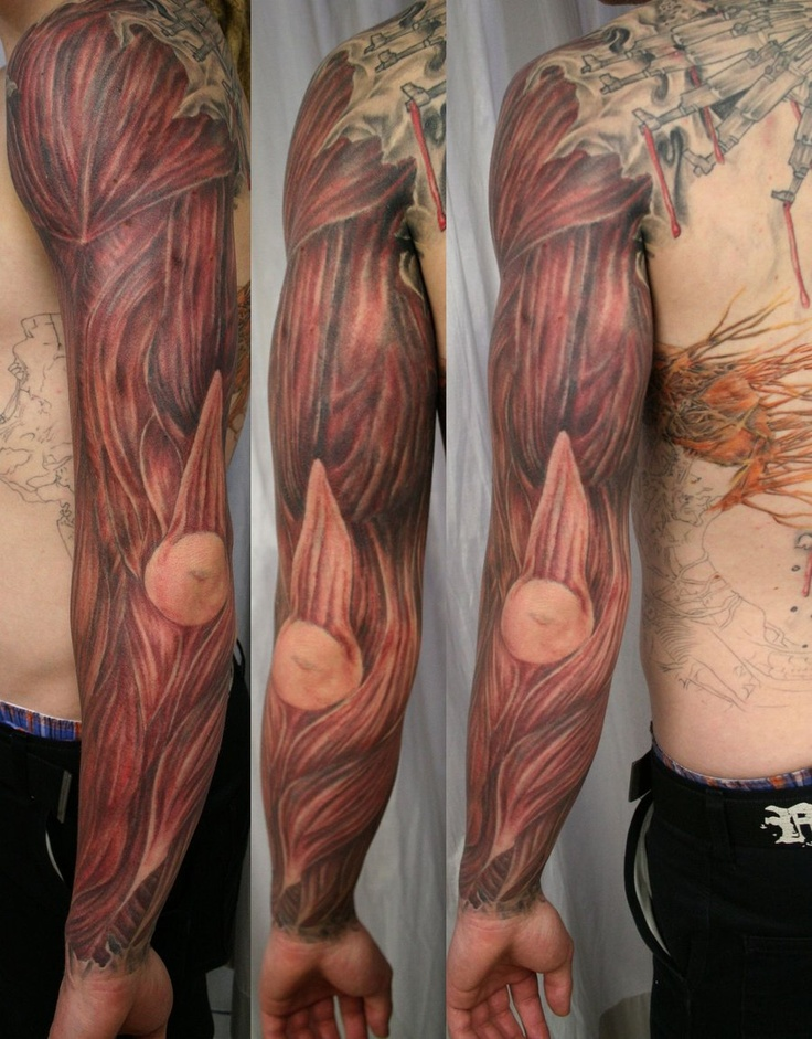 Muscle tattoo on left arm and hand
